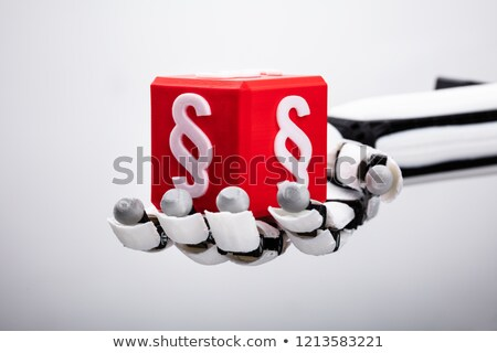 Robot Holding Cubic Block With Paragraph Symbol Stock photo © AndreyPopov