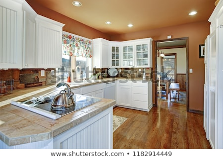 Country kitchen features white cabinets. Stock photo © iriana88w