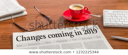 a newspaper on a wooden desk   changes coming in 2019 stock photo © zerbor