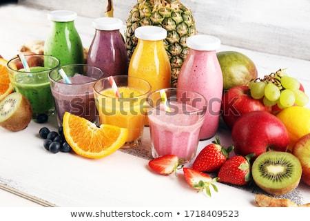 Bottles of healthy fruit juice smoothie Stock photo © DenisMArt