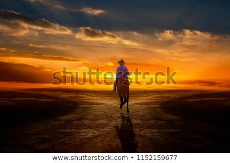 Triste Cowboy séance regarder noir cuir Photo stock © ralanscott
