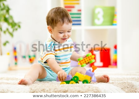 beautiful baby boy playing with toys and smiling stock photo © ruslanshramko