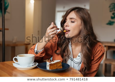 woman eating slice of cake stock photo © andreypopov