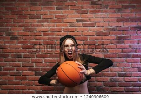 Portré izgatott lány 20-as évek áll téglafal Stock fotó © deandrobot