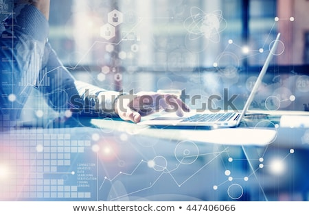 Hand typing on laptop graphs and charts and reports concept around Stock photo © ra2studio