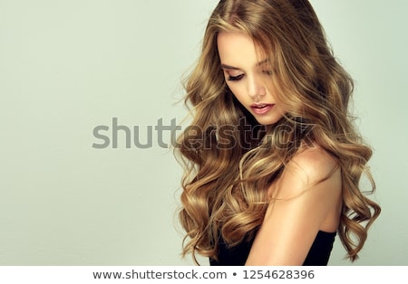 Laughing blonde girl with long and shiny wavy hair . Beautiful smiling woman model with curly hairst Stock photo © studiolucky