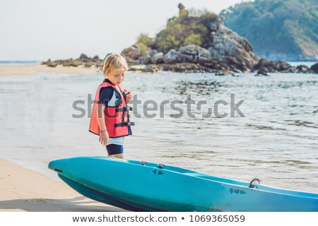 menino · caiaque · água · feliz · floresta · barco - foto stock © galitskaya