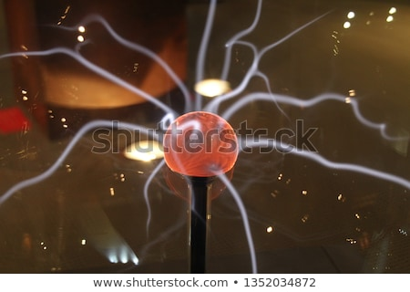 Closeup of an electric energy plasma sphere. Glowing electrostatic ball. Copyspace. Science power de Photo stock © galitskaya