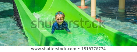 boy and girl have fun in the water park banner long format stock photo © galitskaya