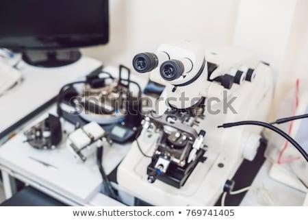 Mikroskop kullanılmış yüzey soruşturma afiş uzun Stok fotoğraf © galitskaya