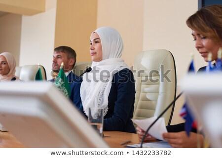 小さな 女性 ムスリム スピーカー 外国の 同僚 ストックフォト © pressmaster