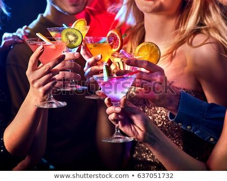 Kadın cam kokteyl gece klübü kutlama parti Stok fotoğraf © dolgachov