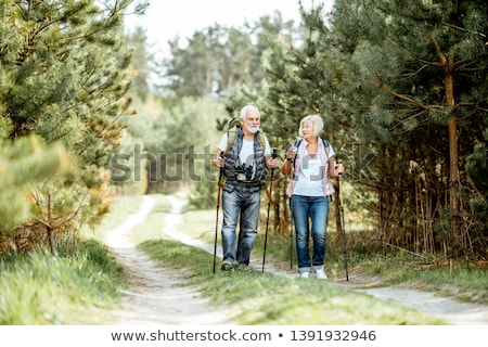 Happy active seniors enjoying trekking trip in the forest Stock photo © pressmaster