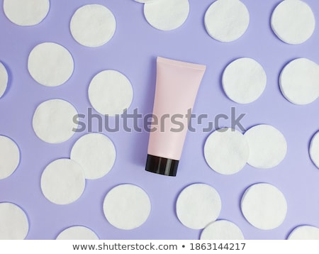Organic cotton pads on purple background, cosmetics and make-up  Stock photo © Anneleven