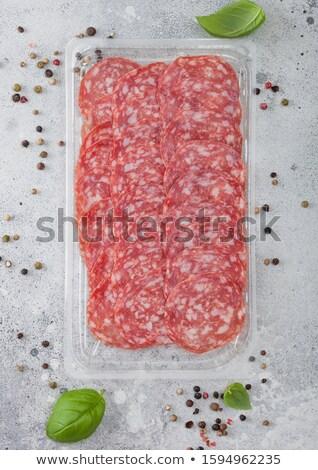 Pack salame fette basilico pepe luce Foto d'archivio © DenisMArt