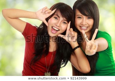 Imagen optimista hermosa Asia nina sonriendo Foto stock © deandrobot