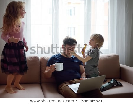 Father with kid working from home during quarantine. Stay at home, work from home concept during cor Stock photo © Len44ik