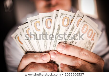 Stock photo: Dollar banknotes in a cash slot