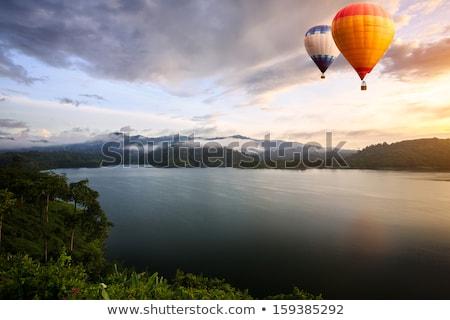 Hot-Air Balloon over Lake at Sunset Sunrise Stock photo © Balefire9