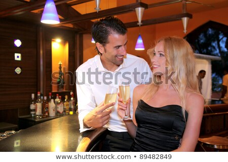 Woman in a chic bar drinking champagne Stock photo © photography33
