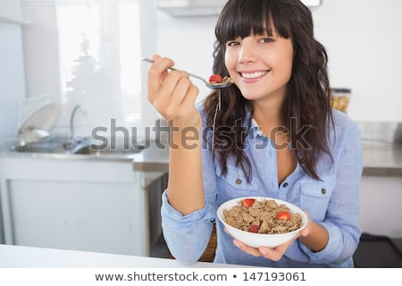 Esmer kadın yeme tahıl gıda gözler Stok fotoğraf © photography33