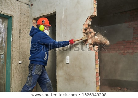 Builder with a sledgehammer Stock photo © photography33