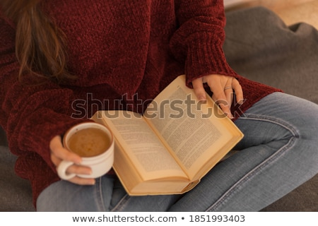Relaxing By Reading A Novel And Drinking Some Coffee Stock photo © stuartmiles