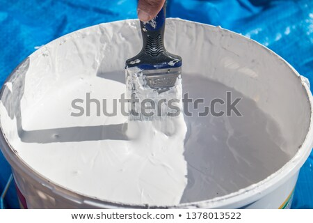 Decorator with a large pot of paint Stock photo © photography33