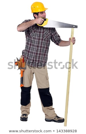Tradesman carelessly sawing a plank of wood Stock photo © photography33