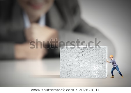Workman pushing an invisible wall Stock photo © photography33