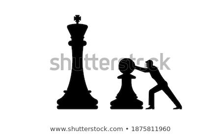 Pequeño blanco ajedrez peón mano nino Foto stock © carodi
