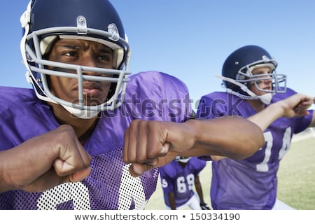 three young football players on a football field stock photo © photography33