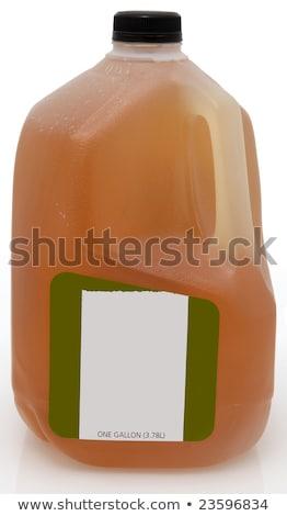 Yeşil çay bir galon plastik sürahi etiket Stok fotoğraf © ozaiachin