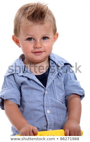 closeup of a little boy with gelled hair using a walker stock photo © photography33