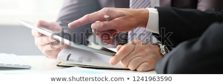Businessman holding out a pen Stock photo © photography33