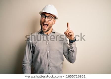 handsome builder in helmet stock photo © dolgachov