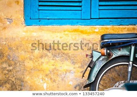 Scooter parked at old building in Vietnam, Asia. Stock photo © kyolshin