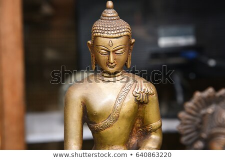Gilded figure of Buddha in the temple. Indonesia Stock photo © pzaxe