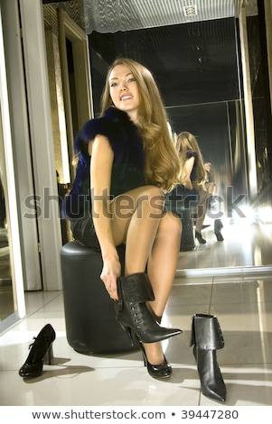 blonde fits on a boots in a boutique Stock photo © ssuaphoto