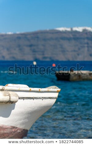 Boat bow in colorful yellow and blue colors  turquoise sea Stock photo © lunamarina