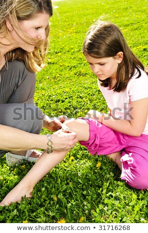woman bandaging scrape stock photo © iofoto