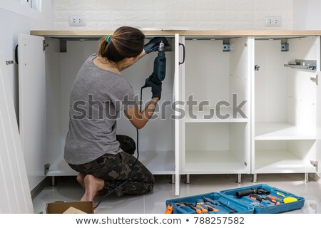 Woman fixing house electrics Stock photo © photography33