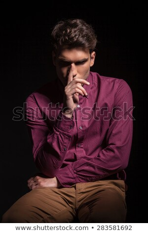 fashion young man with red nose looks away Stock photo © feedough