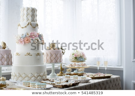 Wedding cake and bouquet Stock photo © KMWPhotography