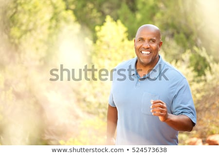 Souriant embonpoint homme marche bras danse Photo stock © Discovod