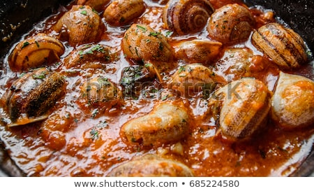 spanish cooked snails in sauce Stock photo © nito