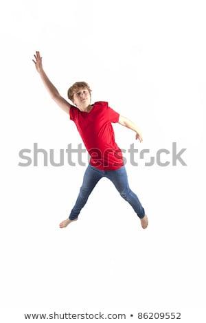 Okos fiú piros póló ugrik levegő Stock fotó © meinzahn