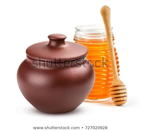 Argile pot miel bois cuillère blanche Photo stock © Elmiko
