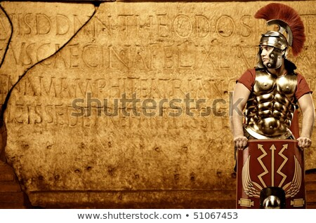 roman legionary soldier in front of abstract wall stock photo © nejron