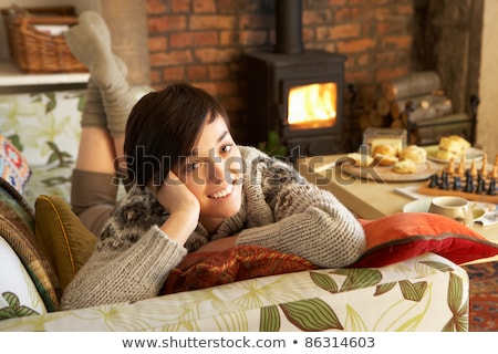 young woman relaxing by fire stock photo © monkey_business